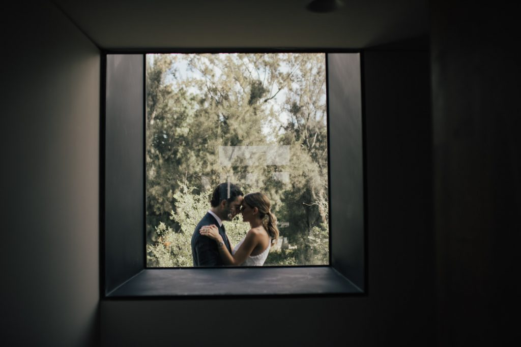 Marrying couple through window.